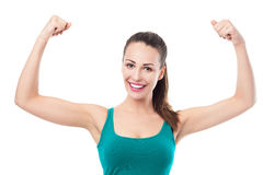 Woman flexing muscles. Over white background Stock Image
