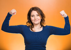 Woman flexing muscles showing, displaying her strength Stock Photo