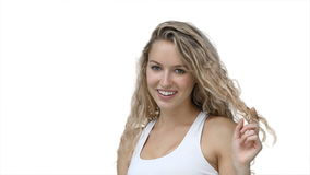 A woman flicks her hair and smiles Stock Photos