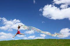Woman Flies On Sky With Piece Of Fabric In Hands Stock Photos
