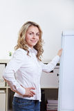 Woman with flipchart in office Stock Images