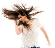 Woman flipping her hair. Cheerful woman flipping her hair while dancing isolated on white background Stock Photos