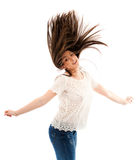 Woman flipping her hair. Cheerful woman flipping her hair while dancing isolated on white background Royalty Free Stock Images