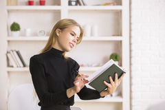 Woman flipping through organizer pages Royalty Free Stock Photos