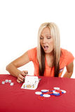 Woman flipping over playing cards Stock Photography
