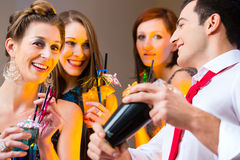 Woman flirting with barkeeper. In cocktail bar royalty free stock image