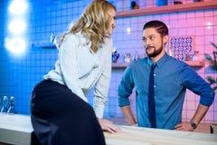 Woman flirting with bartender Stock Photos