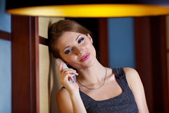woman flirting and chatting on the phone Stock Image