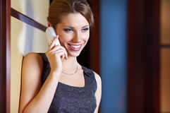 Woman flirting and chatting on the phone Royalty Free Stock Images