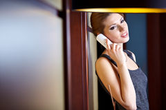 Woman flirting and chatting on the phone Stock Photo