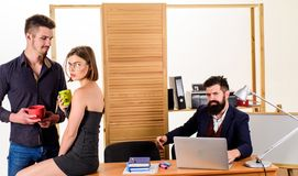 Woman flirting with coworker. Woman attractive working man colleague. Office romance concept. Sexual attraction among royalty free stock photography
