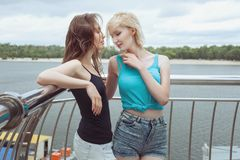 Woman flirting with a friend. Royalty Free Stock Images