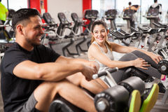 Woman flirting with a guy in a gym Stock Photos