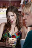 Woman flirting with male friend Stock Images