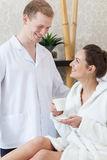 Woman flirting with man in spa Stock Image