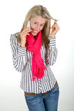 Woman flirting on a phone Stock Image