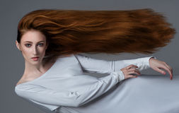 Woman floating in the air. In studio Royalty Free Stock Photo
