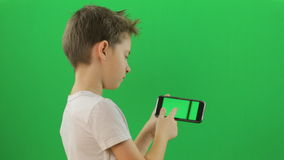 Kid with smartphone device, Green Screen stock video footage