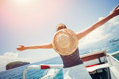Woman floating on the boat near the island. Happy woman floating on the boat near the island Stock Photography
