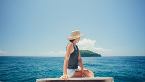 Pretty woman floating on the boat near the island. Woman floating on the boat near the island Royalty Free Stock Photos