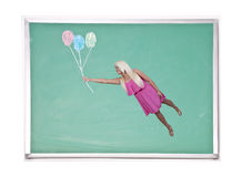 Woman Floating with Chalk Balloons Stock Image