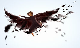 Woman floating   on dark wings Royalty Free Stock Photo