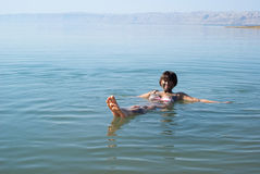 Woman Floating In The Dead Sea Stock Photo