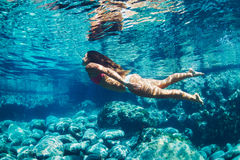 Woman floating in Natural Pool Stock Photo