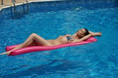 Woman Floating On Air Mattress Stock Images