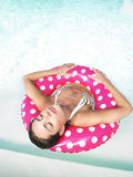 Woman Floating in Pool With Eyes Closed Royalty Free Stock Photos