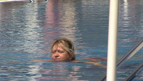 Woman floating in the pool in the resort of Golden Sands, Bulgaria. Varna - the sea capital of Bulgaria, a center of shipping and tourism. Today it is the third stock video footage