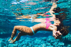 Woman Floating in Tropical Water Royalty Free Stock Images