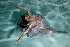 Woman floating under water arms out Royalty Free Stock Photo