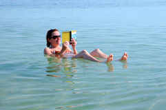 Woman Floats in the Dead Sea Stock Photos