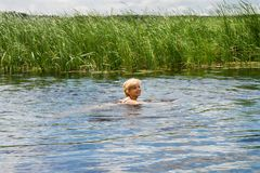 Woman floats in the river Stock Images