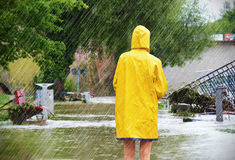 Woman on a flooded street Royalty Free Stock Photos