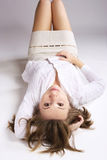 Woman on floor. Beautiful woman lying on floor Stock Photos