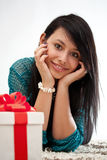 Woman on the floor with gift box Royalty Free Stock Photo