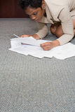 Woman on floor with paperwork Stock Image