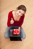 Woman on the floor with a present Royalty Free Stock Image