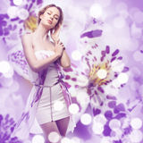 Woman on a floral background Stock Images