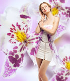 Woman on a floral background Stock Photography
