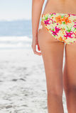 Woman in floral bikini standing back to camera Royalty Free Stock Images