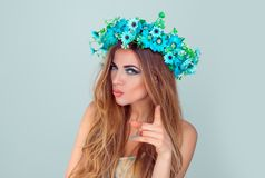 Woman with floral crown on head pointing at you stock image