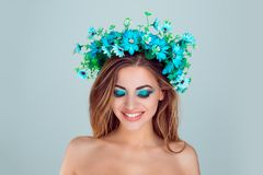 Woman with floral crown on head smiling looking down posing royalty free stock photo