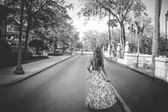 Woman in Floral Dress Standing on Road Royalty Free Stock Image