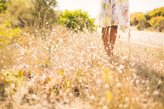 Woman in floral dress standing by the road Stock Photography