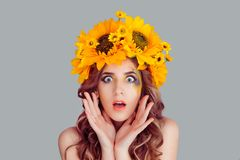 Woman with floral headband looking at camera in shock stock images