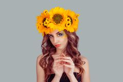 Woman with floral headband plotting something royalty free stock photography