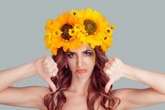 Woman with floral headband with thumbs down stock image
